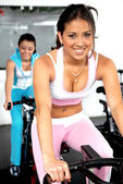 Girls cycling at the gym — Stock Photo