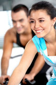 Girl cycling in a gym — Stock Photo