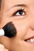 Girl applying make up — Stock Photo