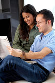 Couple reading a newspaper — Stock Photo