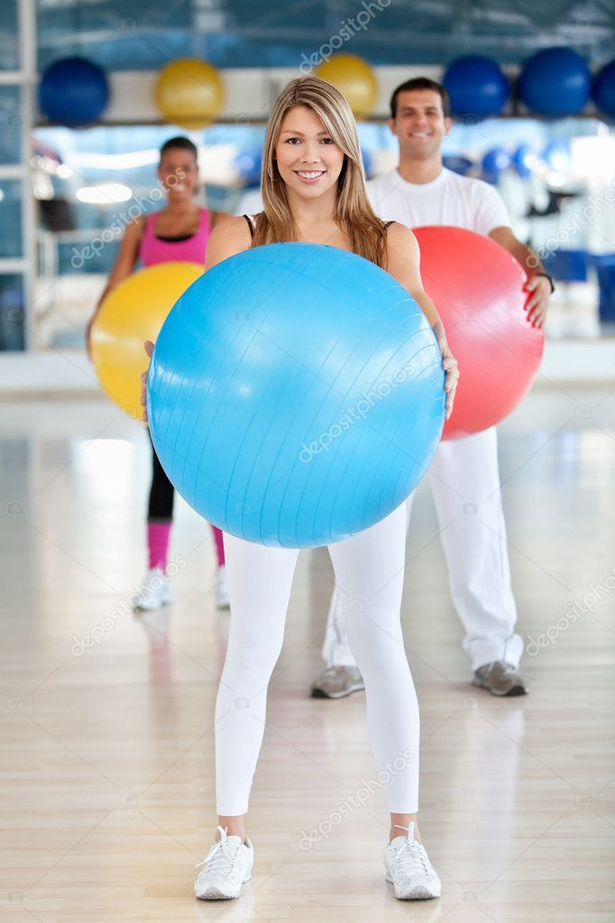 Group of at the gym smiling with a pilates ball  Stock Photo #7770554