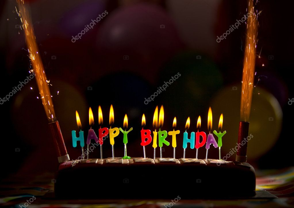 Happy birthday candles on a chocolate cake  Stock Photo #7770906