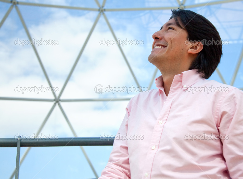 Thoughtful man looking at the sky and smiling in a dome — Stock Photo #7771411