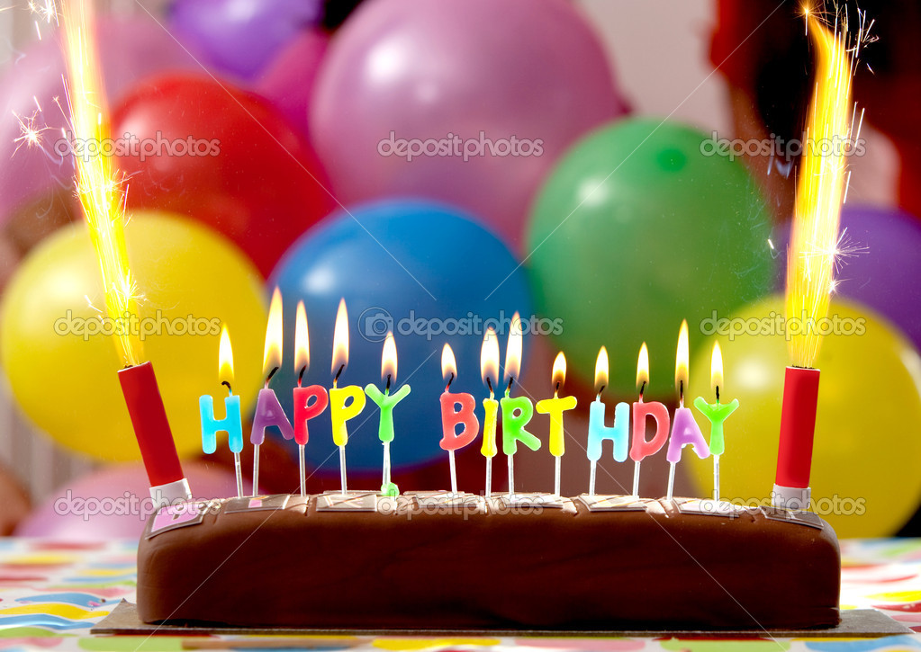 Birthday cake with candles lit up and ballons on the background — Stock Photo #7771476