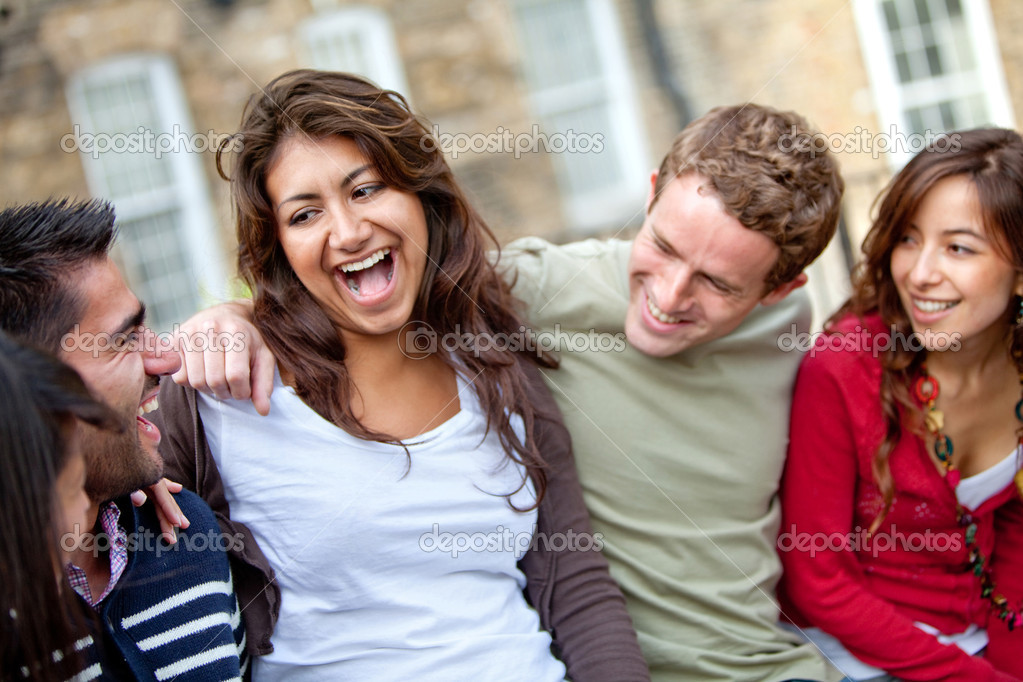 Happy group of casual friends having fun and smiling outdoors  Stock Photo #7771696