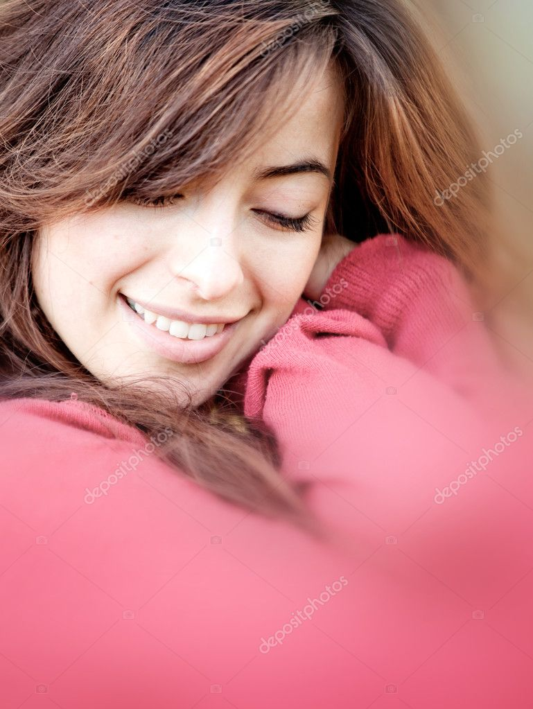 Portrait of a beautiful young woman cuddling and smiling  Stock Photo #7771722