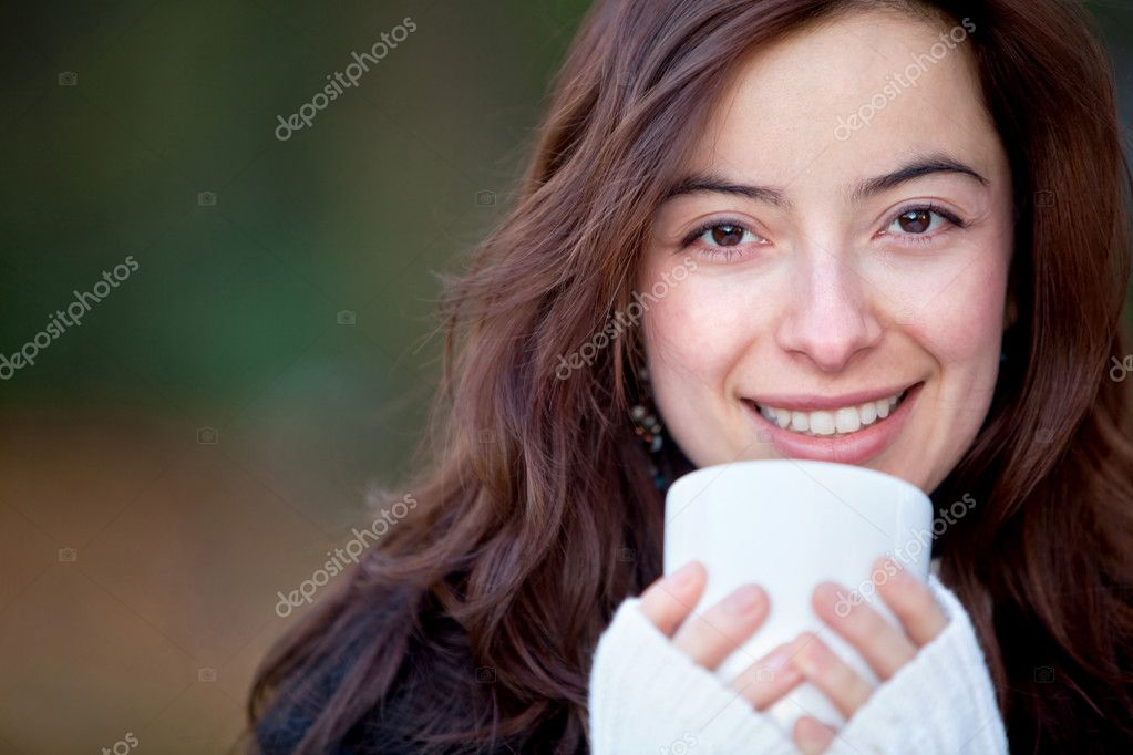 Woman drinking a cup of coffee Ð outdoors — Stock Photo #7772442