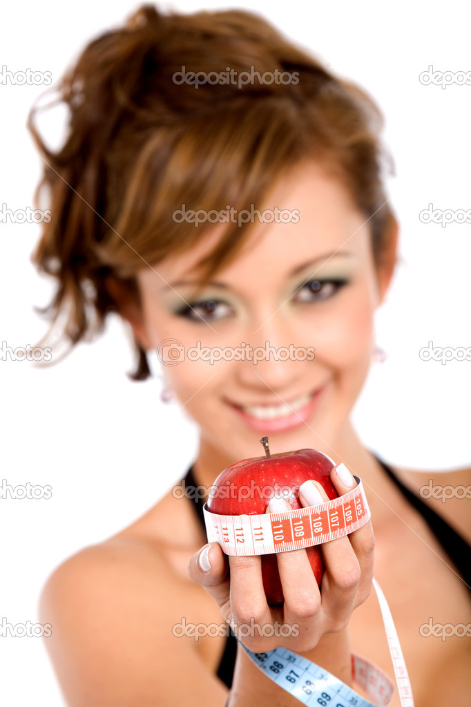 Girl holding an apple while smiling - healthy diet and nutrition concept — Stock Photo #7772663