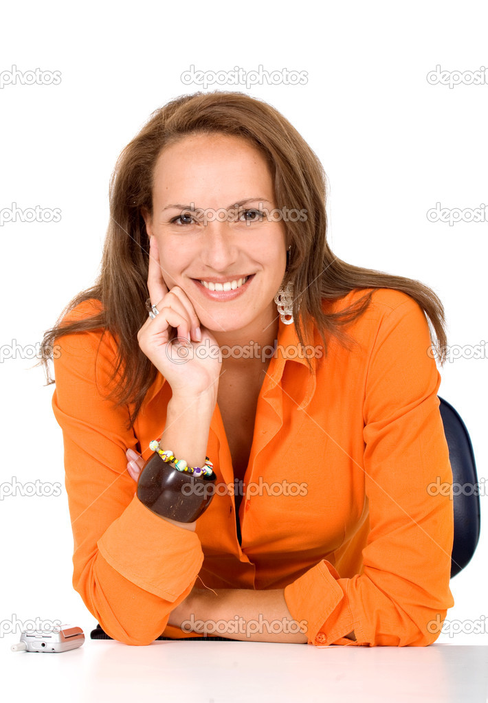 Business woman portrait in orange on her office desk  Stock Photo #7772777