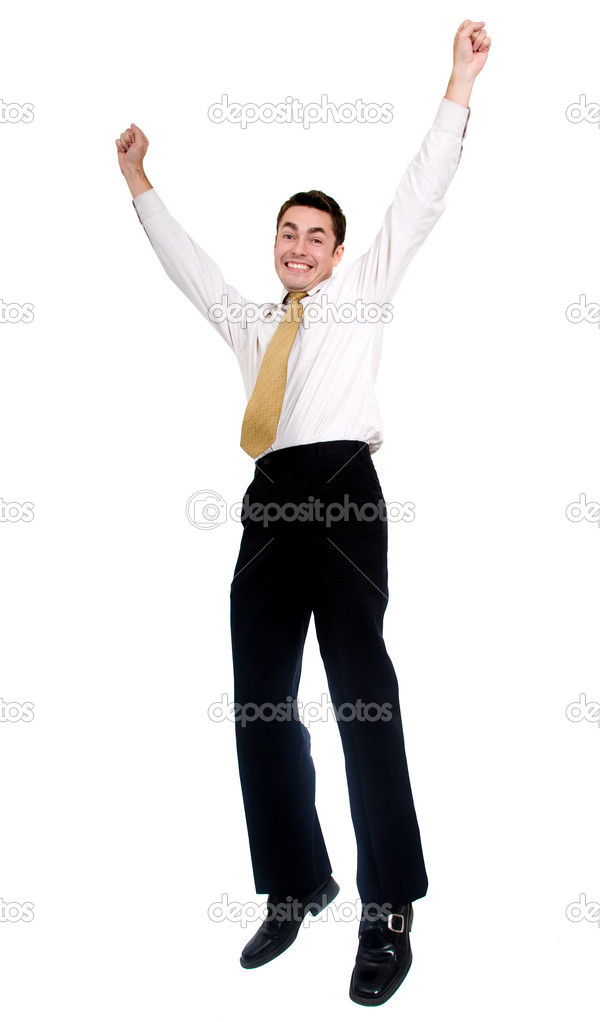 Business man jumping of joy over a white background  Stock Photo #7773325