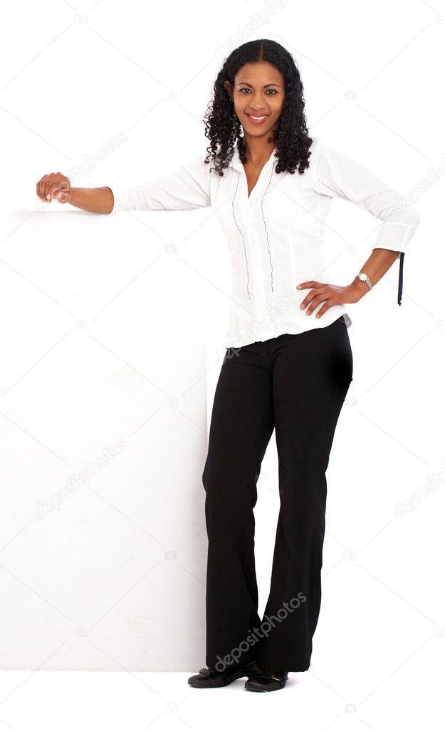 Business woman leaning on a banner add isolated over a white background — Stock Photo #7774675