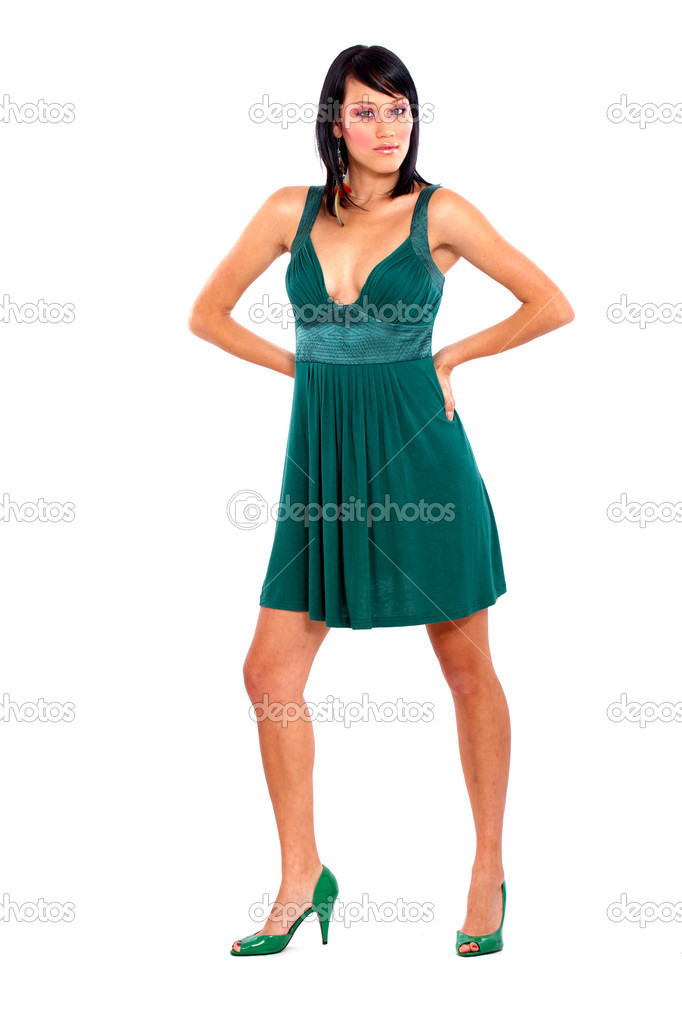 Catwalk fashion woman walking in a green dress - isolated over a white background  Stock Photo #7774807