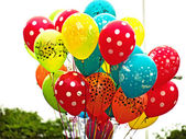 A bunch of bright multi-colour balloons — Stock Photo