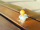 Pacifier on a bench outdoor — Stock Photo