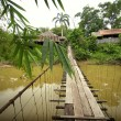Stock Photo: Scenic wooden suspension bridge of local village