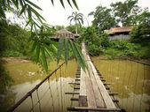 Scenic wooden suspension bridge of local village — Stock Photo