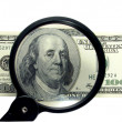 Money and magnifying glass — Stock Photo #7658211