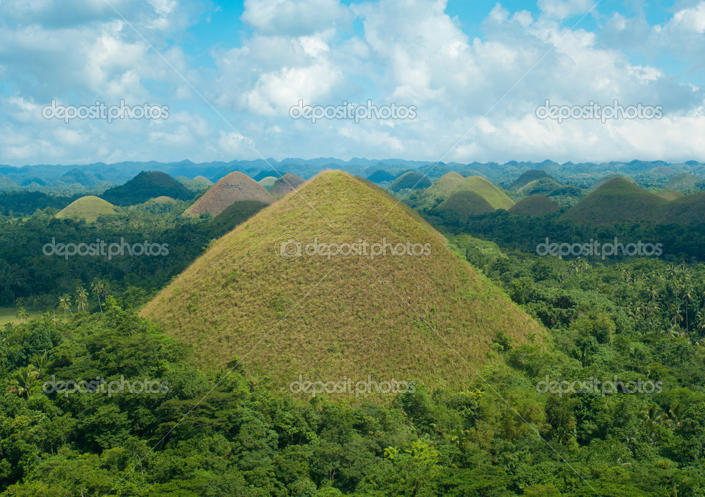 View over the famous chocolate hills on Bohol, Philippines. They are also featured in the provincial flag — Stock Photo #7809160