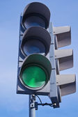 Traffic light showing green light — Stockfoto