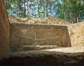 A deep hole dug during archaeological excavations, view from bel — Stock Photo