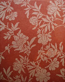 Pattern painted flowers on a bright red background. background — Stock Photo