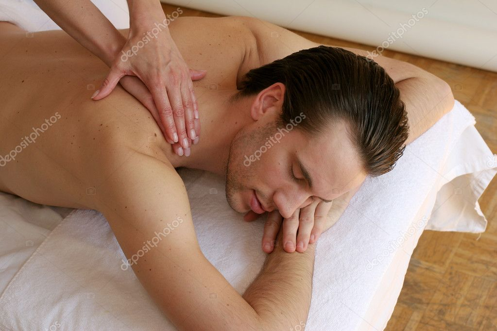 Young man getting a massage — Stock Photo #7603201