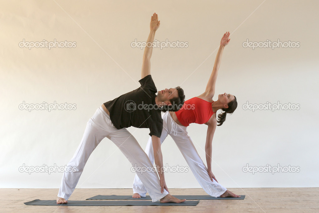 Young man and woman practicing yoga together — Stock Photo #7613783