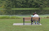 Couple Sitting On a Bench In Spring — Stock Photo