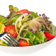 Fresh tomato and lettuce salad with a fork close up — Stock Photo