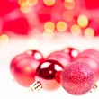 Royalty-Free Stock Photo: Red Christmas baubles over white and red background