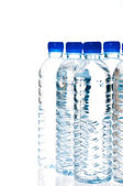 Water bottles isolated on white — Stock Photo