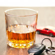 Whiskey neat with a car key — Stock Photo