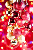 Red and gold Christmas hanging baubles close up — Stock Photo