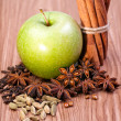 Fresh green apple with spices — Stock Photo