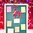 Christmas notice board with reindeer decoration - Stock Photo