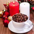 Christmas cup of coffee beans on wooden table — Stock Photo