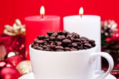 Christmas coffee beans in a cup — Stock Photo