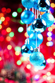 Blue Christmas hanging baubles with lights at the background — Stock Photo