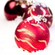 Three Christmas red baubles on snow — ストック写真