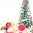 Mini Christmas tree with red and gold baubles on snow — Stock Photo #7802824