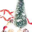 Mini Christmas tree with pinecone and baubles on snow — Stock Photo