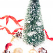 Royalty-Free Stock Photo: Mini Christmas tree with pinecone and baubles on snow
