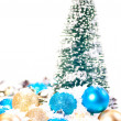 Mini Christmas tree with gold and blue  on snow — Stockfoto