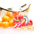 Chinese new year with dragon and ingot — Stock Photo