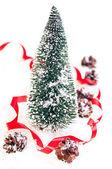 Mini Christmas tree with pinecone on snow — Stock Photo