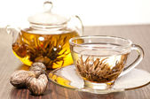 Blooming green tea in glass teacup close up — Stock Photo