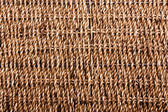 Wicker basket on wire contruction parallel texture background — Stock Photo
