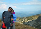 Mountain embrace: Couple in love on the top of Seven Rila lakes — Stock Photo