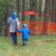 Постер, плакат: The mother with son are going to the start