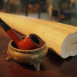Still life. antique pipe in copper rest. — Stock Photo #7787712